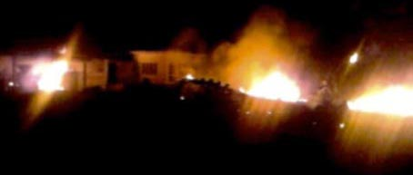 Bin Laden&#8217;s Abbottabad compound in flames. Apparently, the fires are mainly due to a crashed US helicopter. The picture comes from a neighbor&#8217;s cell phone.